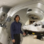 Atchar checks on a patient in the LINAC, February 2012.