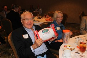 Arnie Grevior with Will Muschamp signed football at Dean's Circle luncheon, 2013.