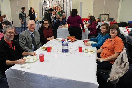 Dr. Dame and others at the 2012 holiday party.