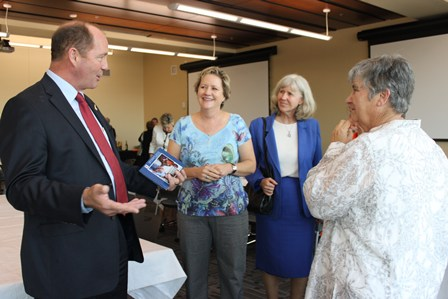 Congressman Ted  Yoho visits with Dr. Laurie Jones, Dr. Lynn Peck and Debby Courtney.