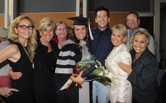 Katie Stender with family members and Suze Orman.