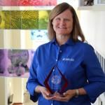 Dr. Julie Levy with distinguished alumni award