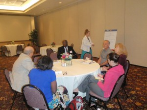 Meeting goers meet in small groups to discuss disability topics and ways FODH can tackle them in Florida
