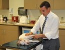 Dr. Pozzi performs orthopedic exam